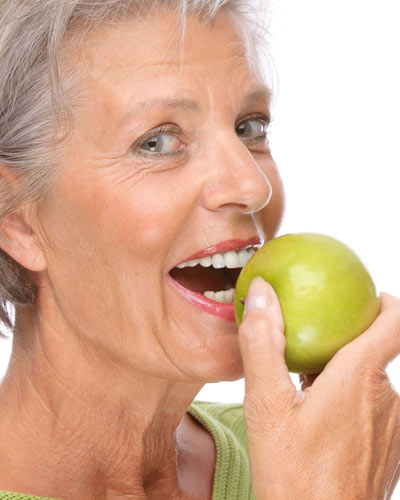 dental implants - eating apple